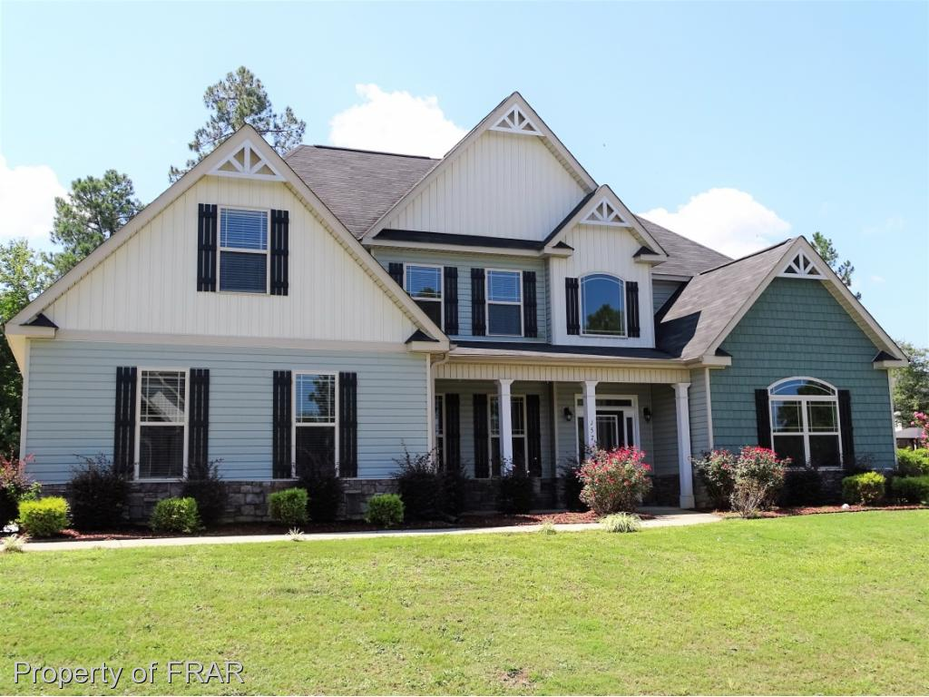 Beautiful 5 bedroom 3.5 bathroom two-story on corner lot with 2 car side entry garage. Home features open floor plan and easy flow throughout! Large great room with fireplace and cathedral ceiling, formal dining room, large eat in kitchen with granite countertops and stainless appliances. Large master suite downstairs and all other rooms are upstairs. Plus enjoy all the amenities of Carolina Lakes!