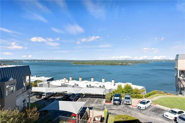 MOTIVATED SELLER! Breathtaking panoramic views of Lake Travis from two over sized balconies to enjoy stunning sunsets. Three bedrooms each with private balconies and private baths. Two fireplaces create a cozy ambiance. Light and bright kitchen with granite counters and stainless appliances. Top notch community amenities include: 2 pools, private docks, fitness center, tennis and sports courts. Too many items included in HOA to be listed. Luxury lake life can be yours!