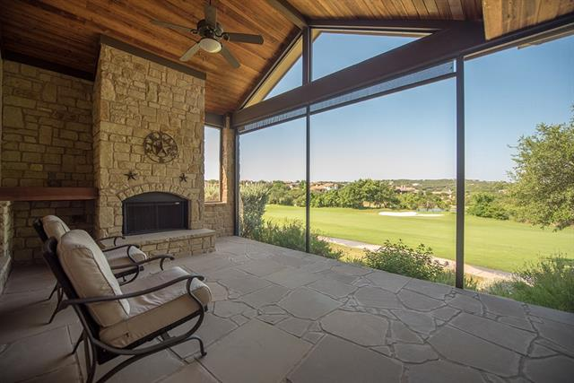 Texas Hill Country style one story villa backing to the 18th fairway of the Flintrock Falls golf course. Custom open concept floorplan with spacious combined living and dining room plus breakfast room all open to a cook's kitchen with stainless steel appliances, granite island & pantry. Tile flooring throughout except for study, which boasts beautiful Mesquite hardwoods. Screened in patio with fireplace overlooking the golf course and pond. Oversized garage with golf cart/workshop space, sink & cabinets.