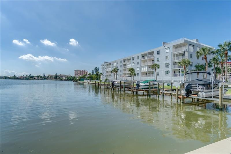 Enjoy the best of both worlds Gulf Views and Sunsets, Beach Access, and Intracoastal views and Sunrises. This well maintained remodeled Furnished condo with 2 bedrooms, 2 full baths, split plan and washer and dryer in the Condo on the Intra Coastal has large 20 x 20 tile floors thru out the condo. The kitchen is newer with newer appliances and granite counters.  Enjoy views of the Gulf from your front door and breakfast area. Enjoy Sunrises overlooking tranquil Travertine Island, Dolphins and Boat Traffic from you living room, master bedroom, and your private covered balcony with electric storm shutters. Afternoons on the Balcony are ideal for Reading and Entertaining.   Parking is in the under building, secured, deeded, parking space # 18 with addition storage for your bike and beach things and plenty of guest parking outside. Slips may be rented from owners if available from the private boat docks.  This well kept complex has a Heated Pool, and Public Tennis courts. Don't Miss another Sunrise or Sunset.