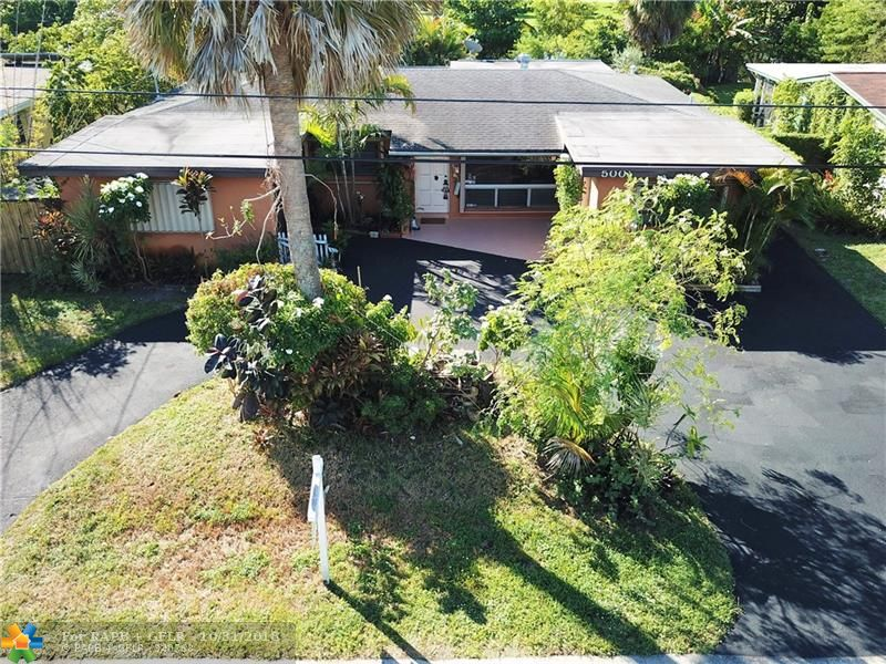 Exc location. Priced to sell. Easy to show. Lowest priced riverfront oasis in Wilton Manors. Terrific floorplan. Separate In-law suite/office/studio. Split beds. Needs updating. 1CG. Huge Lanai. Oversized tropical pool. Large yard w/edible fruits. Natural N-fork of Middle River meanders behind. Join Kayakers & paddle boarders touring round the Island City! Super quiet street. Near shopping, entertainment, trendy Wilton Drive, beaches, hwy, bus', downtown FTL, AP & cruises.