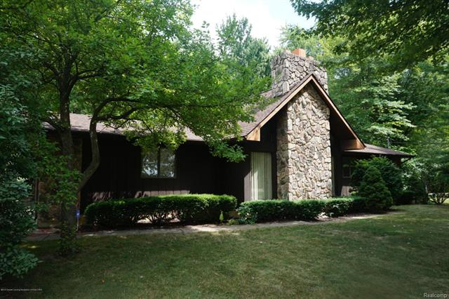 Private 5 acre lot with 3 bedroom 2 bath home!  St. Johns schools, but close to Dewitt and Lansing.  About half of the property is wooded and has abundant wildlife.  Large deck overlooks the woods and trails.  New roof installed spring of 2018.  Cathedral ceilings in living room.