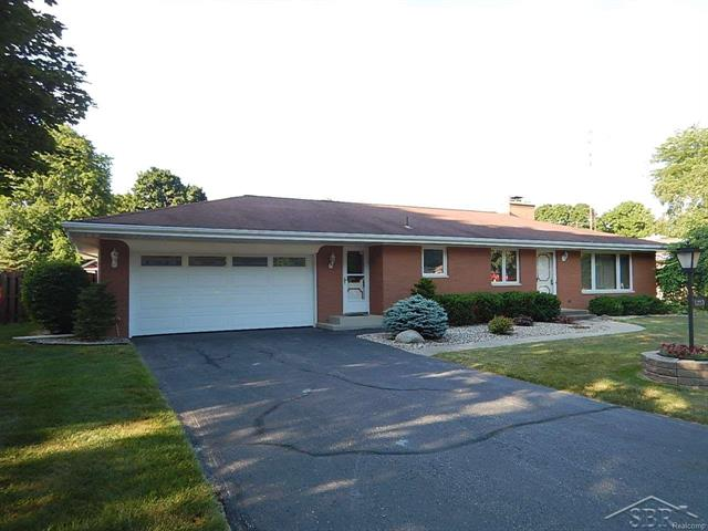 Check out this immaculate one owner brick ranch home in a great Saginaw Township neighborhood!  3 bedrooms, 1 1/2 baths, large updated eat-in kitchen, and living room with fireplace.  The large basement with a bar and a second fireplace is a great place for the man-cave or to entertain!  A four season room over looking the beautiful backyard with a  Beattie inground pool.  Newer roof, A/C, furnace, and garage door opener.  This home definitely shows pride of ownership, and would be a great location to raise a family!