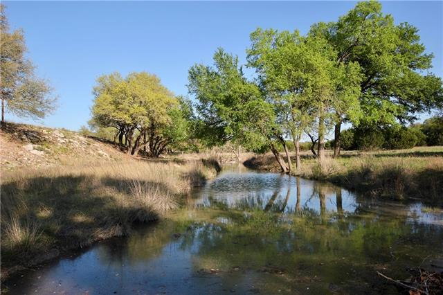 A very unique opportunity to own both sides of Flat Creek on this 46 acre agricultural exempt tract located just west of Dripping Springs. Notable Flat Creek traverses the mid section of this property uniquely providing approximately +/-1,400ft of both sides of the creek. Newly improved with clearing and water features. Perfect location with paved frontage. Excellent home sites! A very special property!