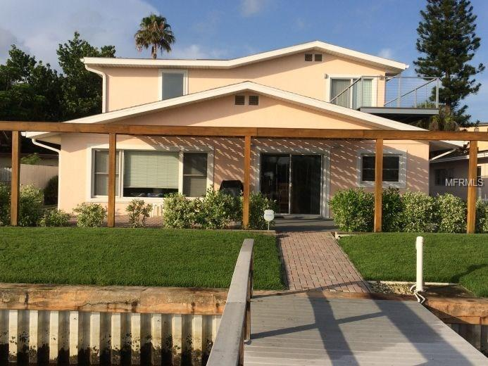 This could be your dream beach house! Barrier island living allows you to park your boat out back, and walk to the Gulf just a block away. 4 bedroom/3 bath. 3 car garage. 30' dock with boat lift on Intracoastal channel. Open floor plan with lots of great features. Shown by appointment only.