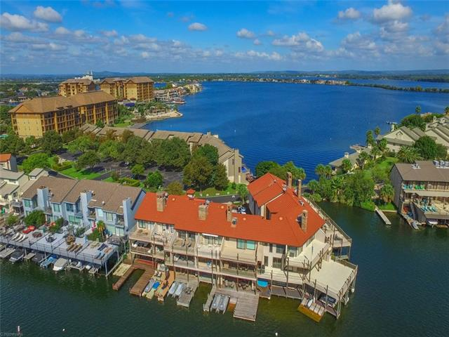 Incredible southeast facing waterfront townhome located in the heart of the amenity rich Horseshoe Bay Resort area. Features include open water, spacious living, large kitchen, lakeside master, multiple decks, double boat slip, jet-ski ramp, hot tub, 2-car garage, abundant outdoor living and gorgeous lake views. Life on Lake LBJ will be nothing short of unforgettable with this exceptional waterfront property. This townhome complex is vacation rental friendly.