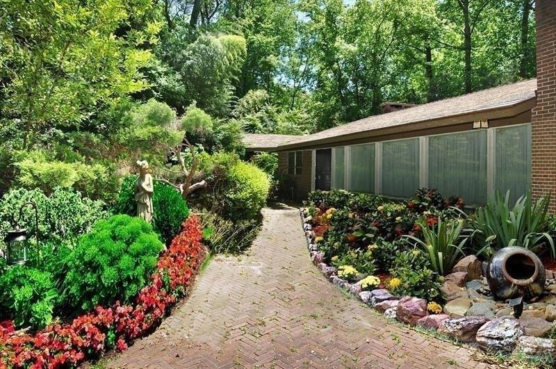 Prime Buckhead location within walking distance of Morris Brandon. Incredible lot with house site/sites situated out of street view.  Perfect opportunity to build your dream home on this picturesque 3 acre lot. Existing home is 4-sided brick, has been partially renovated and has an expansive family room with fireplace, living room with woodwork and fireplace, floor to ceiling windows, wine storage closet, and oversized master bedroom. The private, park-like backyard features a customized, heated, saltwater pool & waterfall feature. Sold AS IS. Could be two lots/sites.