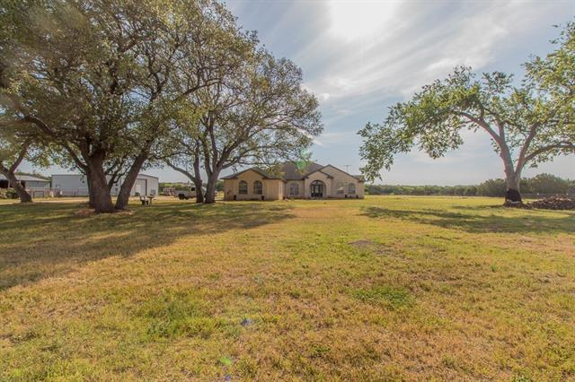 Serene setting for this beautiful country home on 11.921 Acres. 3 bedroom, 3 1/2 bath, office, 2 living spaces, 2 dining spaces, large laundry room, and a 3 car attached garage. In ground pool in the back yard. Large work shop (approximately 40'x50') includes an office area with a window unit heater/air conditioner. A 40'x50' slab is also right next to the work shop. 3 sided barn, fenced for livestock. Beautiful oak trees, are sprinkled all over this property. Come see it for yourself!