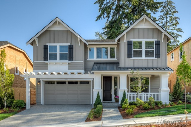 Redmond's newest craftsman inspired community by Village Life; Hillbrooke Crest. Timeless beauty meets modern, comfortable living throughout. The Woodland floor plan greets you with an abundance of natural light, crisp, clean finishes & seamless transitions between each living area. Over-sized bonus room, outdoor dual fireplace living area, Chef kitchen & floor to ceiling stacked fireplace bring a un-rivaled level of elegance to intentional living. Completion scheduled for Nov 2018.