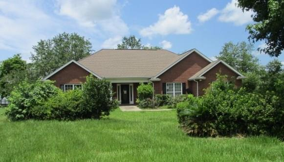 Well maintained brick home with 2099 sq feet and a 3 car garage. Large master suite with master bath including a garden tub, double vanity, and separate shower.  Great kitchen featuring a breakfast bar that opens up into the living room. Outside there is a great screened in back porch perfect for your view of the lake.