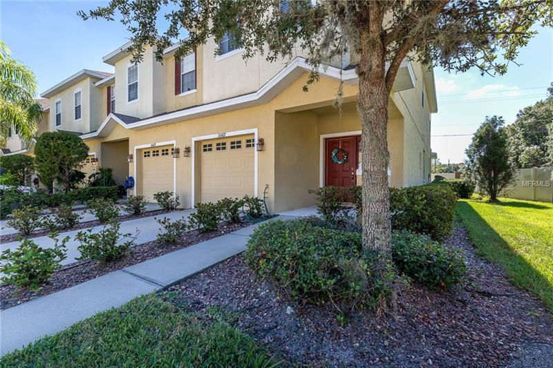 Light, bright and open 3 bedroom 2.5 bath end unit townhome in gated Avelar Creek South with a 1-car garage! Stunning upgraded tile throughout first floor!  Kitchen includes 42