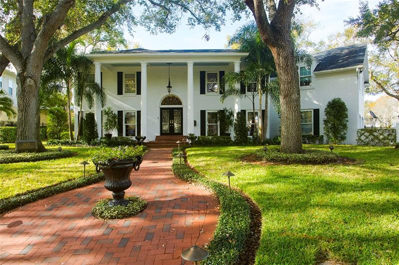 We're proud to present this white brick colonial style remodeled WATERFRONT home in the most sought after Gated community of Culbreath Isles.  This 5 bedroom and 5 and ½ bathroom home with a separate office sits on an oversized lot that has over 137' of water frontage on a deep water canal, bordered by a wrought iron fence.  This traditional home with modern improvements is located on a quiet cul de sac with over 15,000 square feet of property.  This beautifully renovated home boasts a newly remodeled kitchen with Thermodor appliances and Subzero refrigerator that opens to a family room with 10' ceilings and an open layout.  The expansive master wing offers the new owners a retreat with a large master bathroom, a large dressing parlor and a feeling of stepping up into their own world with a large bedroom with views down the canal to the open water. Two of the secondary bedrooms upstairs have their own en suite bathrooms. The 4th bedroom attaches to a hall bath and lives like an in-laws quarters with a hidden wet bar area; while the 5th bedroom being used as a children's retreat accesses the same bath from the hallway. Located in the desirable school system of Mabry, Coleman, and Plant with easy access to Tampa's finest private schools, airport, and fine dining.  Minutes from the open water of Tampa Bay, whether by land or sea you will be able to connect to all Tampa has to offer.