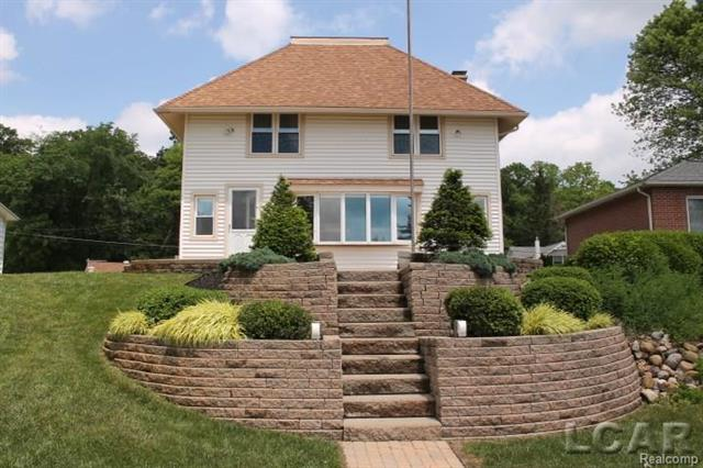 58 FT SAND LAKE LAKEFRONT!  One of a kind home, renovated approx. 7 years ago.   Renovation included:  new furnace, central air, water softener and water filtration, paint throughout, kitchen cabinets with soft close drawers, island and granite countertops, brick paver patio and stairs, tilt in windows, ceramic floor in kitchen, laminate wood throughout 2nd floor and much more. Open floor plan with plenty of natural light.   Detached 2 car garage and shed near lake with separate electric. Well pump replaced within the last 3 years.  70 ft. of alumi-span dock with perma-augers.   Property is being sold furnished.  House is set up to sleep 13 but can sleep more.  2 additional parcels are included in this sale.  1 has garage on it and the other is vacant.  So many possibilities for the new owner!