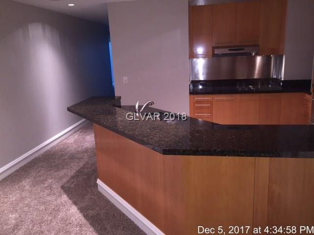 STUNNING LUXURY CONDO LOCATED ON THE WORLD FAMOUS LAS VEGAS STRIP.  CORNER UNIT WITH AMAZING PANORAMIC STRIP VIEWS/MOUNTAIN VIEWS FROM PRIVATE WRAP AROUND BALCONY!!!  DUAL SPACIOUS MASTER SUITES WITH LARGE BATHROOMS.  ADDITIONAL 1/2 BATHROOM FOR YOUR GUESTS.  FLOOR TO CEILING WINDOWS.  MANY ADDED UPGRADES.  OPEN KITCHEN WITH GRANITE COUNTERS.  BUILT IN APPLIANCES.  NEW CARPET AND PAINT.  THIS CORNER UNIT LOCATION IS RARE AND HARD TO COME BY!!