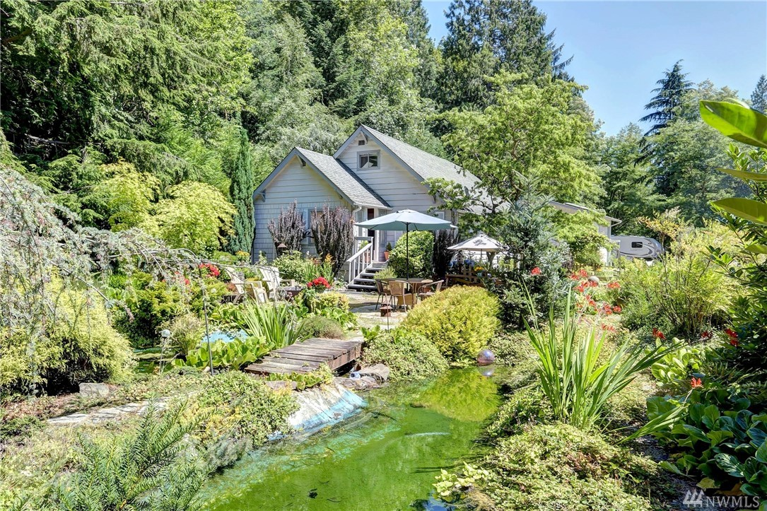 WOW! This is a one in a million property that you will NOT find anywhere else! Beautifully renovated cottage home on huge 2.8 acre lot! This home has so much unique character, you can truly see how loved it's been. Enjoy this quiet oasis in the incredible outdoor space surrounded by lush gardens, forest and the sounds of the creek running in the back of the property. Prime Bear Creek location in Woodinville, close to golf courses, parks and easy access to freeways. This home will not last long!