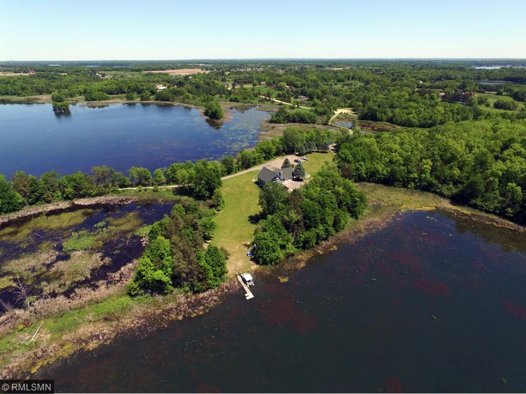 Breathtaking private peninsula with over 6 acres of panoramic wildlife & water views. Over 1500' of private shoreline on School & Mattson Lake -good fishing & recreation! One level living with 2 bdrms on main flr, walk-out level with 2nd kitchen & mom-in-law living. Open loft family rm & master suite w/whirlpool bath. Secluded hot tub & sauna by the lake. Dock, 3 sheds, 8 garage stalls. 2 level, drive through attached garage. Must see this one of kind awesome property!