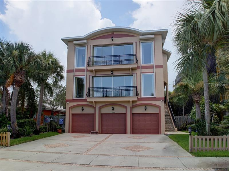 $100,000 RENOVATION INCENTIVE AT CLOSING!  For those in the know... the far north end of Clearwater Beach offers the Olde Florida aesthetic we all moved here for... lush, unspoiled foliage and landscaping, private gated and deeded beach accesses, and a short stroll to the many amusements the Renaissance district offers with its restaurants, pubs and charming Island shops.  The distinguished and landmarked Carlouel subdivision within this tony stretch of Gulf and Bay presents this newer construction home that allows for vast rooms with volume ceilings, two complimentary master suites - the one offering direct Gulf and shoreline views, the other possessing garden exposures, an open kitchen, elevator access and an enormous downstairs recreational space that is simply cavernous in scope... This property affords geography and water exposures you have been looking for, without the maintenance and logistical issues direct waterfront homes encounter.