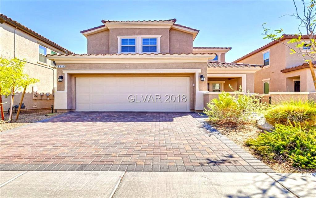 Upgraded Home in guard gated community of Tuscany. Featuring over 2,250sf with 3 full bedrooms (optional 4th bedroom downstairs), full living room & family room with fireplace & entertainment niche. Kitchen offers stainless steel appliances, granite counters, custom backsplash & bar. Tile flooring, custom shutters, laundry room with modern Washer/Dryer. Custom landscaping in the backyard with pavers and artificial grass. Priced low to sell fast
