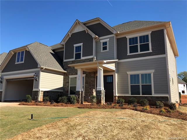 The Worthington features an open floorplan with guest suite on the first floor! Open gathering room with double sided stone fireplace to Covered rear porch. Enjoy relaxing on your porch viewing common open space and pool!