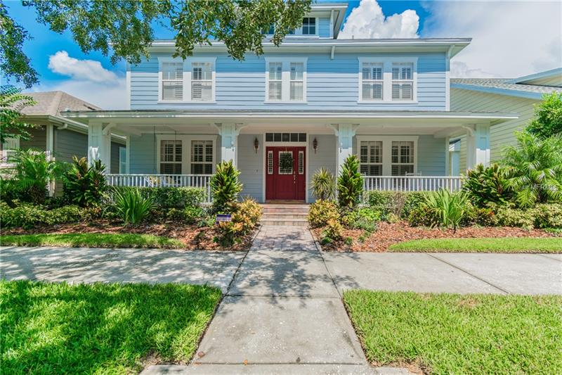 """Nestled on sought after Brompton Drive, this Classic Neo-Traditional home is neighborly & welcoming, right in the heart of West Park Village in Westchase. 4 BRs, 3.5 BAs, Office + Loft w/3CG. The charming porch will soon become your favorite place to relax & replenish, smiling away your day w/your coffee in hand & POND view-true Southern Perfection! Upward-Soaring ceilings + lofty windows w/Plantation Shutters flood this home with elegance, while RECESSED LED lighting throughout the downstairs & HARDWOOD floors keep home light & bright. The floor plan flows intuitively, both aesthetic & functional. The modern chef's kitchen features GRANITE, pendant & recessed lighting, 42"""" WOOD cabinets, a 2016 5-burner BOSCH GAS stove, the sweetest dining nook w/bench seat, as well as a massive WALK-IN PANTRY. Enviably spacious, DOWNSTAIRS Master BR is a dreamy retreat w/En-Suite BA feat. Garden Tub, GLASS walk-in shower + HUGE custom Walk-In closet. Upstairs you will find a LOFT + 3 BR, 2 BA inc. a Jack-n-Jill. Step outside to your fully fenced oasis, inc. a screened in entertaining area w/luxury cabana, pavers + fire feature. This gorgeous home boasts 2017 HVAC, 3 NEST Thermostats, updated irrigation system w/French drains, new interior & exterior paint w/in last 3yrs + 2016 TANKLESS GAS Water Heater. A stone's throw from Westchase's coveted restaurants, shops, and activities, you will have access to pristine parks, playgrounds, community pools, basketball + tennis courts, nature trails & more. ASK for feature sheet."""