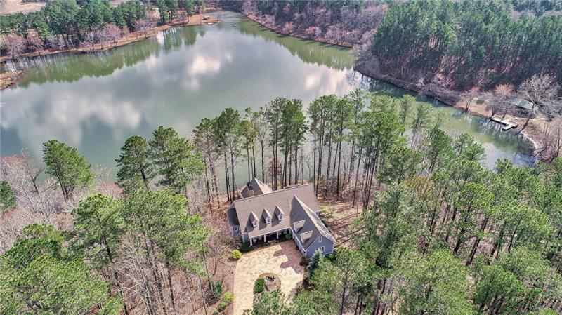 Stunning custom lakefront hm on almost 4 acres. Located at the end of a cul de sac in a small community just outside of the Big Canoe® community, home overlooks a 22 acre private lake w/tons of privacy. Hm feat open flr plan w/huge greatt rm w/lake views, sep dining rm, custom kitchen, bfast area, mud rm, Master on main, w/2 addtl bedrooms & screened in porch w/fp & retractable screens. Terrace level feat 2 spacious bedrms & full bath, bonus rm w/fp & access to covered deck & lake views, wine cellar, & unfinished space for addtl rms/storage. 2 car garage & circular drive