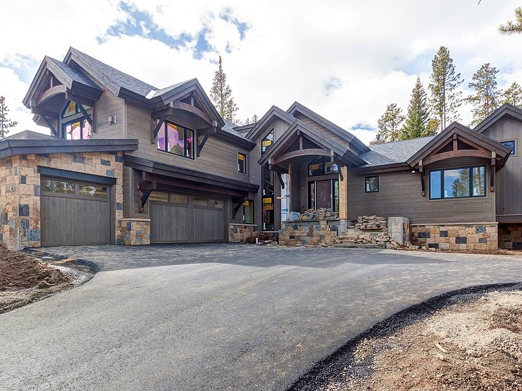 This mountain contemporary home is a true work of extraordinary craftsmanship.  A private wooded setting that backs to open space with amazing views of Breckenridge and Baldy Mountain!  Ski in/ski out access and a short walk to town make this the premier home on the market.  5 bedrooms all ensuite that are privately set on 3 different levels throughout the home.  Arched beams, multiple outdoor living spaces, two wet bars, a wine room and a three car garage.  To be completed by Christmas.