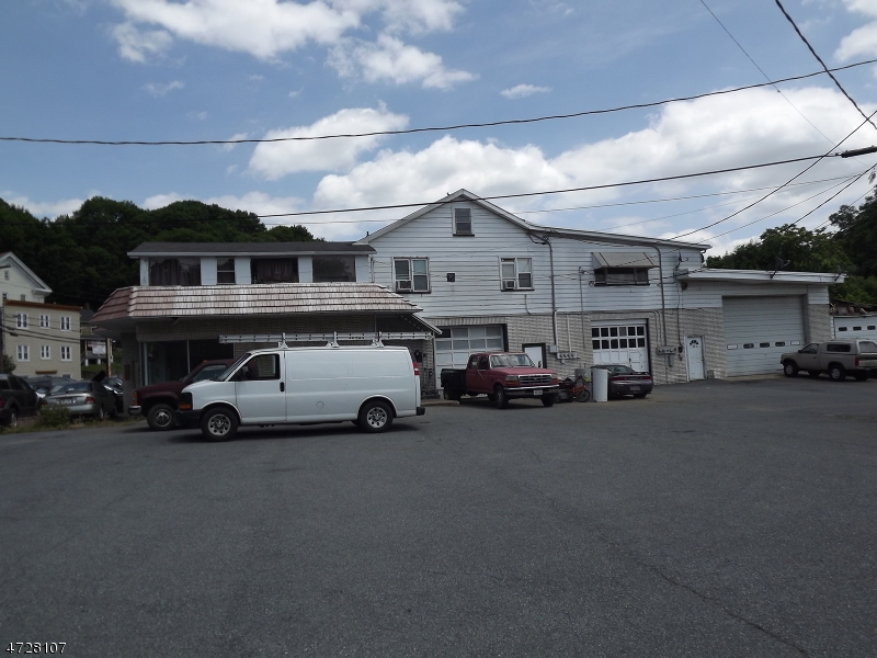 Great opportunity - Sale includes (5) lots (34,35,36,37,38) and a total of 1.48 acres.  Large commercial building with 3 bay garage facing S Main St. and 3 other bays on side of building.