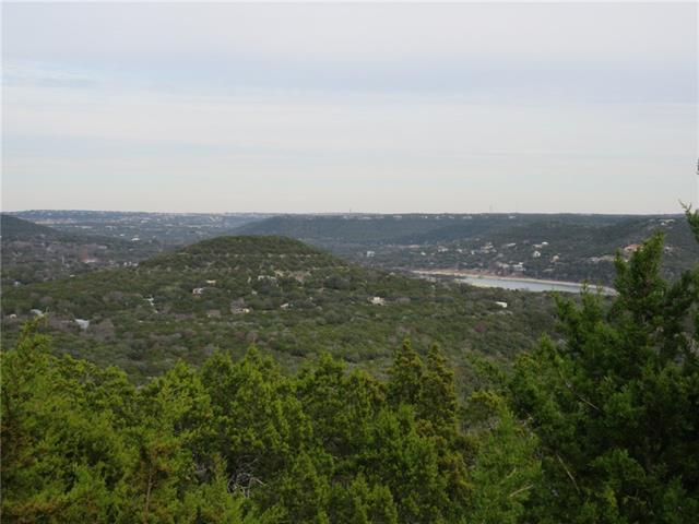 180 degrees stunning, panoramic hill country and lake view!! 10+ Acres that start at the top of the mountain and terraces downward to the bottom. Gravel road is runs alongside (but not passable towards the middle) the length of the property.  Beautiful build sites and abundant wildlife. NOT IN CITY LIMITS!!! Restrictions are minimal, and horses are allowed!! Extremely private! It has several special features!