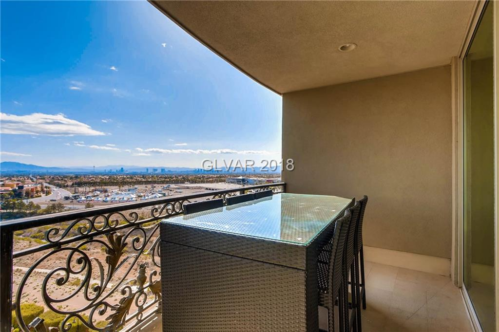 2 Bedroom split floor plan with incredible strip, city and mountain views in sought after luxury One Queensridge Place! State-of-the-art appliances, separate office, stone floor, custom drapes in great room. Amenities include indoor and outdoor heated pool, luxury spa, fitness area, movie theatre, private guest casitas, 24 hour security and a barista. Also includes a cooled private 2 car underground parking garage.
