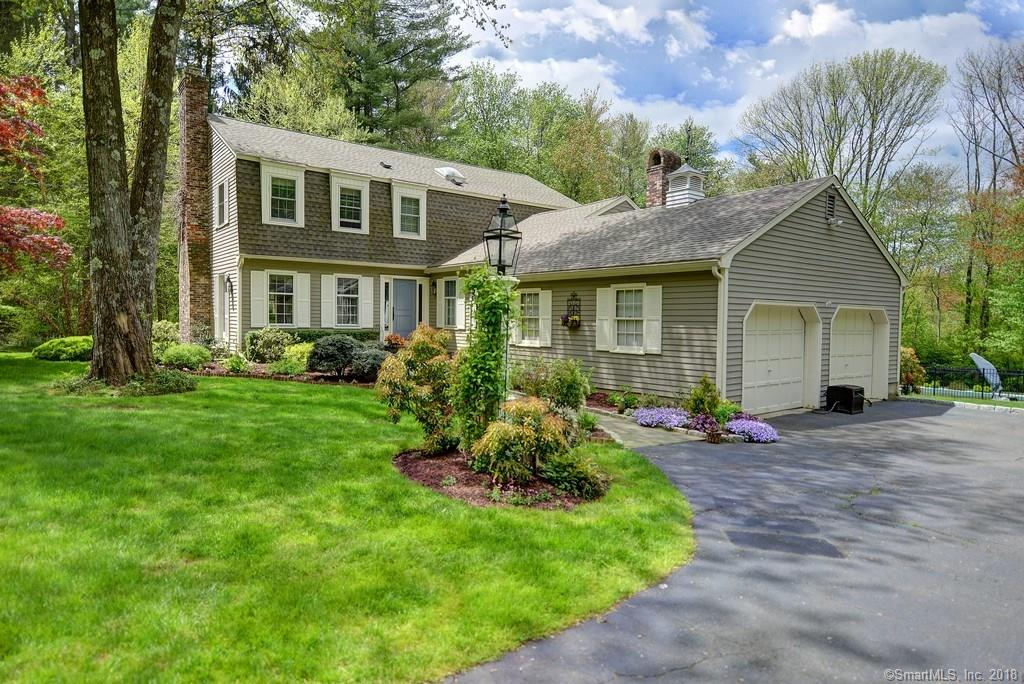 "This Greenfield Hill Haven will have you packing your bags & ready to move in! Boasting +3200 square feet, this home has room for everyone & includes a fabulous outdoor deck & in-ground saltwater pool. If you desire a gourmet kitchen then this one's for you! Renovated kitchen features a massive marble center island that everyone can gather around for casual meals.The gourmet cook in you will certainly adore the top of the line appliances. A sunny family room w fireplace will warm up many winter evenings.Just off the family room is a sunroom that will be a fabulous setting for dining al fresco. Formal Living & Dining rooms flow seamlessly & also feature french doors & a gas fireplace.The coffered ceiling study/office will brighten up any dull work that must get done.Upstairs, a spacious Master Suite features a large WIC & full bath. Three add""l bedrooms & full bath complete the upper level.The finished area of the lower level is spacious & features a wood-burning fireplace along w loads of storage space in the unfinished areas. Lush & Green- the setting of this home could not be more beautiful: wooded areas at the front of the driveway open up to lushly landscaped grounds featuring mature perennial plantings. You'll quickly discover why so many value the Greenfield Hill lifestyle: you're close enough to chat w your neighbors at the bus stop or on your daily walk/bike ride AND at the same time enjoy the privacy that 2-acre zoning affords you.The absolute best of both worlds!"