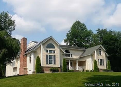 Set on a beautifully landscaped and secluded 2.58 acres, this 4BR 3.5 bath colonial contemporary home has lovely lake views which become spectacular in  winter months.  It offers the best of all worlds.  Relax in a country setting at an inviting 20x40 in ground pool but travel just 1.5 miles to the Merritt Parkway allowing for a short commute to lower Fairfield County and New York as well as nearby shopping. The unique custom floor plan is exquisite.  A double story entry with sparkling granite floor and stunning curved staircase flows into a spacious living room with fireplace and french doors to the dining room which boasts a cathedral ceiling, 2 story windows and sliders to a flagstone terrace.  This terrace also leads to the main level master bedroom.  The gourmet u-shaped kitchen has granite countertops, an island with cook top stove and a walk in pantry large enough to include the laundry. Vaulted ceilings, palladian windows, balcony overlooking the dining room and kitchen, 2 fireplaces, two main level master bedrooms,  as well as a lower level exercise room and 3 car garage are just some of its special features. Energy efficient home with 2x6 studs for extra insulation and a recently installed solar  system (owned, not leased) includes a warrantee which is transferable to the new owner and renders exceedingly low electric bills...so enjoy central air without a care.  Make time to preview the many extra amenities of this spectacular home.   Just stunning!