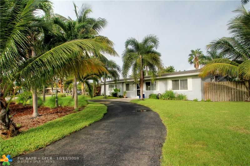 Be careful, no pushing - but hurry! This updated stunner has 2 beds/2 baths (convertible back to 3 beds) on a huge, oversized point lot with room for a pool & your boat. Split your time between expansive, serene outdoor spaces & the designer interior with quartz countertops, stainless Bosch & Whirlpool appliances, & cedar lined walk-in closets. This is a home for entertaining, so it's a good thing there's parking for at least 10 cars! The recreation/laundry room is easily convertible back to a 1-car garage. And throw in the Floranada school district no less.