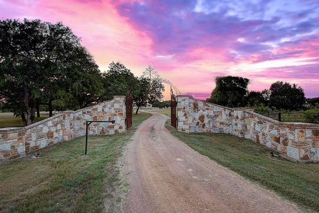A Stunning piece of Texas! Private,29 acre,Gated Equestrian Estate,wildlife exempt on Salado Creek. Mature Oak & Pecan Trees. Custom home built with style & comfort,high ceilings,open plan, energy efficient & elegant features. Chef's Kitchen,all appliances convey,linear fire pits & Generator. Amazing 4 stall barn with dog kennels,half bath,wash bay & more. 80'x50' workshop with 2/2 apartment, 4 overhead doors & 30'x80' awning. Live the life of quiet luxury just north of Austin! CALL for Showings!