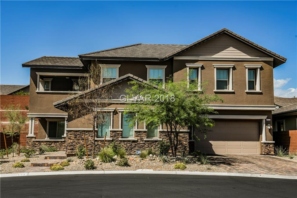 This gorgeous Summerlin home is in a gated community. The home is grand and put together Exquisitely! The floor plan flows to include plenty of storage & great utilization of space throughout! A front Foyer lights up your eyes w/some 20 Ft ceilings. The Kitchen ,is a Chef's Delight w/ granite countertops, large island, walk-in pantry, casual dining area including formal dining room. Upstairs has a lovely loft space leading to balcony w/nice view!
