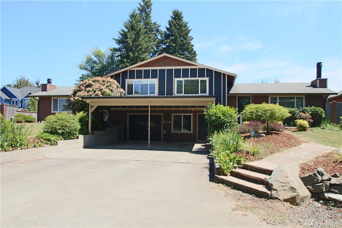 Fantastic Duplex on nearly 2.5 acres! Zoned for Duplex/Four Plex, close to all Tumwater ammenities. Each unit has 2 beds / 1.5 bath, great room, kitchen, dining, laundry, and extra finished rooms on lower level, all appliances included! Each unit has a fully fenced back yard - one w/beautiful rock pond, the other is bigger w/fenced garden area and outbuilding. Gravel driveway takes you to acreage behind - plenty of room for RV storage, gardens, and more! Beautifully landscaped front yard!