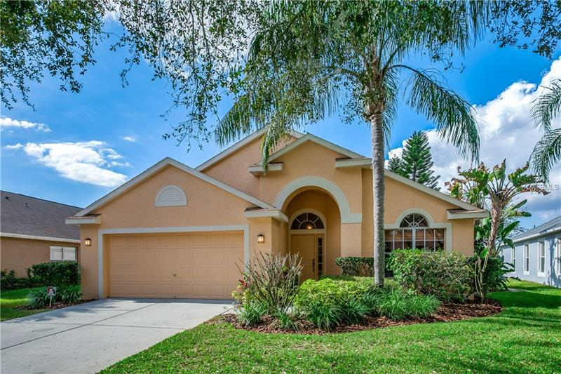 TERRIFIC 4 BR/2 BA 1-Story POOL HOME w/GORGEOUS POND VIEW in HIGHLY-DESIRABLE, centrally-located WESTCHASE community in GREAT SCHOOL DISTRICT.  Roomy split floor plan w/GREAT LAYOUT.  LARGE EAT-IN KITCHEN w/BREAKFAST BAR is open to FAMILY ROOM w/CATHEDRAL CEILINGS, FIREPLACE & view of PAVERED POOL AREA & GAS-HEATED SPA.  LARGE, COVERED LANAI just outside family room to enjoy the view, read a book, or grill out, even when it's raining.  The POND VIEW invites great wildlife including egrets, heron, ducks, turtles and more… so relaxing.  LAMINATE FLOORING THROUGHOUT for beauty/easy cleaning.  Master bedroom has CATHEDRAL CEILINGS, sliding glass doors to pool and WALK-IN CLOSET.  LARGE MASTER BATH has DOUBLE SINKS, WALK-IN SHOWER & separate garden tub.  3 other bedrooms offer lots of room for family/visitors.  Large living room at front of home could possibly be converted to a home office at minor cost.  Close to so much! WALKING/BIKING DISTANCE to , Westchase Elem. & Davidsen Middle School, QUAINT WEST PARK VILLAGE (restaurants, shoppes, sprayground, playground, festivals) & Baybridge Park (playground, shelters, etc.).  MILES OF BIKING/JOGGING/WALKING PATHS, 5 mins. from BEAUTIFUL library, grocery, daycare, medical offices, 10 mins. to great shopping, restaurants, & 20 mins. to Tampa Int'l Airport & BEACHES!  Westchase is one of the PREMIER NEIGHBORHOODS in Tampa nestled in a park-like setting with TWO community pools, Swim & Tennis Center (with lessons/teams), 18-hole golf course/club and so much more.