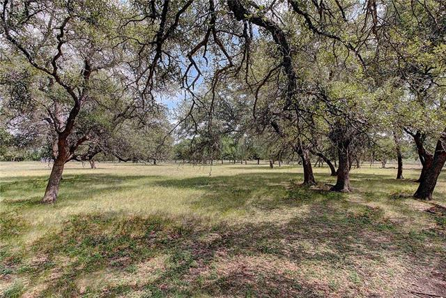 9 unrestricted oak tree covered acres in the growing town of Bertram.  This property has city sewer and water at the street.  This tract could be used to build a custom home on for someone looking for a larger lot.  It could also be developed into a 20+ lot subdivision for affordable homes.  Or it could be a great restaurant site with lots of large oak trees for outside entertainment.