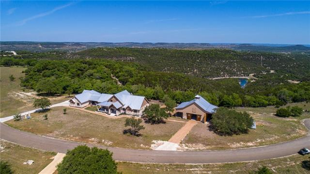 7ac ranchette embodies the finest living Hill Country has to offer. Stunning barn w/ 3 stalls, workshop & storage for an RV. +/-520 sf casita is sure to please the most discerning guest. Captivating views from every window illuminate an open floorplan w/ modern rustic touches. Soaring trusses & fireplace create a farm house feel open to the dining area & kitchen. Tranquil master boasts enchanting vistas & spa like bath full of natural light. Breezeway shades the outdoor living space ideal for entertaining