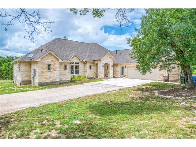 Amazing custom home in sought after Sundance Ranch and the Liberty Hill ISD. Large rooms, custom features include, wood beams in living room, gourmet kitchen with upgrades galore. A one of a kind laundry/mud room complete with a pet shower, built in kennel. Outdoors entertainers delight with an enclosed porch and outdoor kitchen WITH a sink and fridge. Two stall barn for the horses with water and electricity and a tack room and storage for hay and farm equipment.