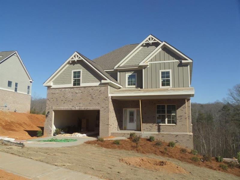 Prestigious new construction in beautiful Lake Lanier community. Take advantage of presale pricing & pick all your select finishes and customize this great home. The Azalea Plan offers 4 bdrm/3 baths, full basement, granite countertops in kitchen, wood flooring, all baths & kitchens tiled, crown molding on main, stainless appliances, and smooth ceilings throughout. The neighborhood will offer available assigned boat slips to community dock, or dry boat storage area, Clubhouse with pool, & community playground. Boat ramps also available 1/2 mile away at Robinson Park.