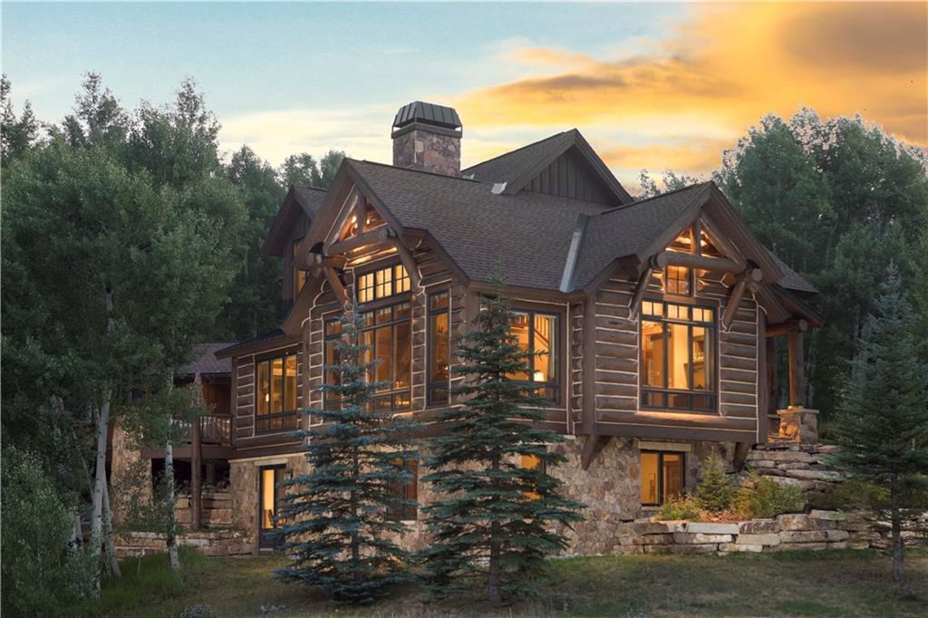 This log-sided home in Three Peaks is situated on nearly 4 acres bordering National Forest.