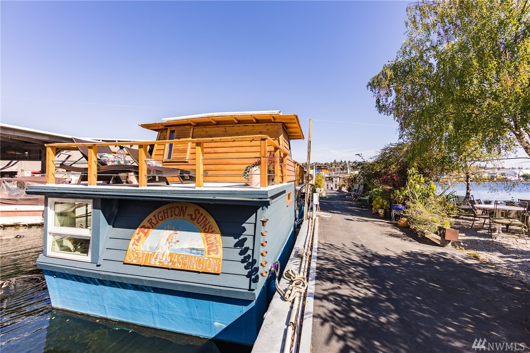 Adorable, cottage-like housebarge with wood planked ceilings and modern, wood accents including two beautiful live-edge countertops, custom stone sink, Japanese-style aromatic cedar soaking tub, custom fir elevator bed, real shoji doors. Across from waterfront garden. This home is a unique opportunity to live on the ship canal, minutes from downtown, UW, and more. Enjoy the view of Fremont from your rooftop deck, or sit in comfort and style in your open concept living room.  376' of decks!