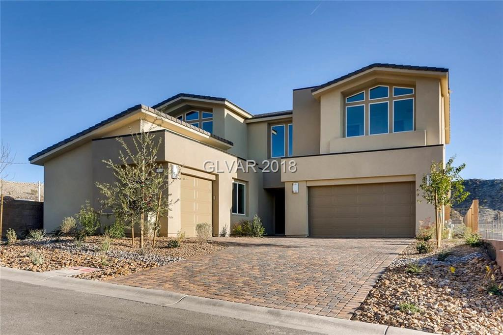 Beautifully appointed William Lyon Home in the resort style living of Lake Las Vegas.  This 4 bedroom home includes a multi-gen bedroom with living room.  Oversized corner lot, upgraded flooring, cabinets and counters.