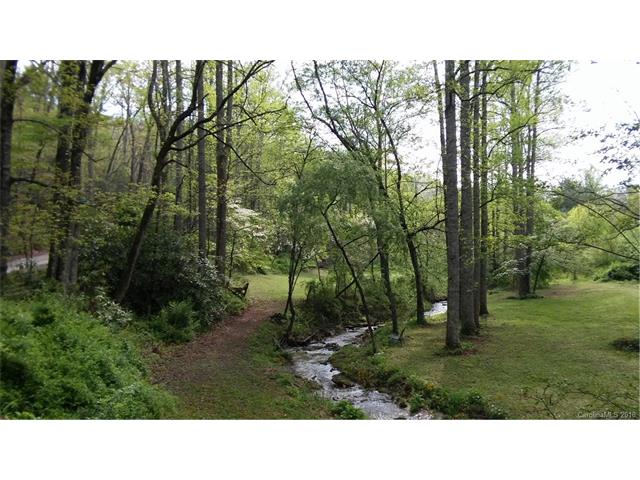 BEAUTIFUL LOT WITH BOLD MOUNTAIN STREAM!!!. 2 bedroom septic and shared well are in, as well as the temporary power pole. Ready for you to build your dream cabin! Level lot. Located off Terry's Gap Road about 20 minutes from Hendersonville, east side of Henderson County. Easy access to Hendersonville east side shopping as well as Asheville via Fletcher/Terry's Gap Road. The owner has architectural plans for you if you want them. Just Ask! No Mobiles Allowed