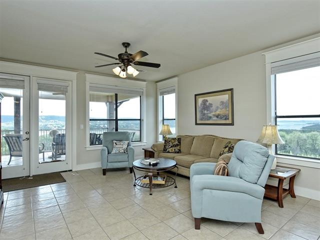 Beautiful views of Lake Travis on your own covered patio. Wonderful 3 bedroom, 3 bath condominium is located on the 3rd level of the building. The Hollows has a private resort beach club, marina, boat ramp and breathtaking views!This villa has the best view and floor plan of the existing inventory. It is a must see premium Hollows Hilltop Villa. The views from almost every corner will amaze you.  Come visit and imagine the lifestyle.  Vacation Rental optional.