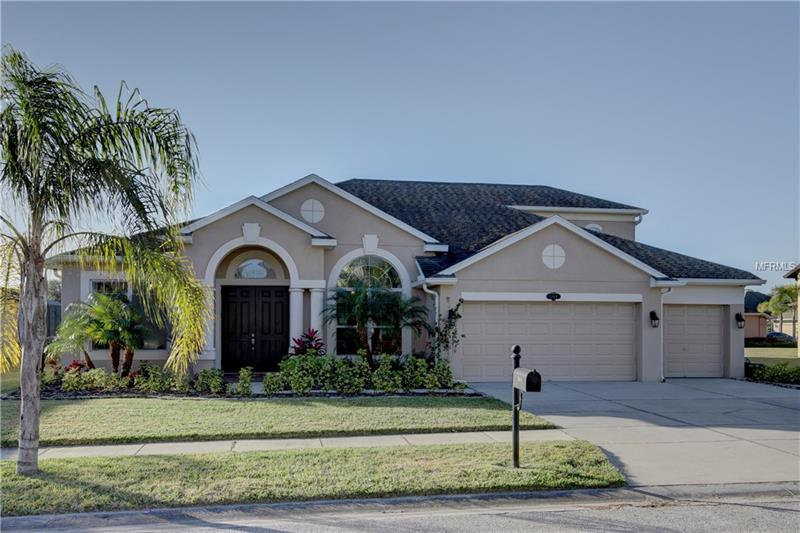 This M/I built home, is located in a gated community of only 20 homes & offers an oversized lot with a premium view of a beautiful pond. An inviting front porch provides the entry into an expansive living room/dining area with unobstructed views of the pool & pond beyond.  High ceilings &  gleaming wood floors provide an elegant look with plenty of space & options for entertaining. To the left of this grand space, is an office with  wood flooring,  glass entry doors & front window for plenty of light.  Also on this side of the house, is an oversized Master with a sitting area and sliders to access the lanai. Large walk in closet as well as the dual sinks with wood cabinets & granite counters. A tub & separate shower complete this bath retreat. On the other side of the home, an open kitchen/ family room offers an island work space with many cabinets & granite counters along with stainless appliances. The breakfast nook & the sliding doors in the family room offer views &  access to the brick paved lanai & pool decking. The Sellers installed the pool at great expense & added a beach entry, sun shelf with bubblers plus a raised spa with hydrotherapy jets.  The rock waterfall, flagstone coping & pebble sheen finish complete the look. A 2nd story bonus area also has a bedroom & bath with a large finished storage area. NO FLOOD INSURANCE REQUIRED.