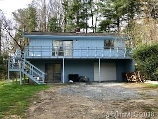 Home & mobile home on 4 acres.  Also rental space for third home.  Gentle property, two wells on property, located off Garren Road (state maintained).  Home features open living, dining & kitchen, two bedrooms & full bath.  Lower level heated by wood stove has studio, full bath, bonus area & one car garage.  Good rental history.