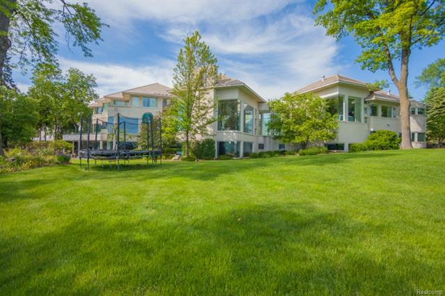 With more than 260 ft. of lake frontage on beautiful Upper Straits Lake, this spectacular home has been completely renovated for today's discerning buyer.  Incredible views can be enjoyed from every window.  This home boasts grand architectural flourishes & fine finishes throughout. The opulent master retreat features vaulted ceiling, sitting room, phenomenal closets & luxurious bath with exquisite tile, Lalique inlays,Mahogany insets & huge steam shower. The sleek chef's kitchen with custom cabinetry flows seamlessly into breakfast nook/sitting area &  to the expansive family room. There are many options for relaxing & entertaining whether it's in the rich wood-paneled library, the intimate living room or in the LL with billiards room, workout room, 2nd kitchen, 2nd laundry room, sauna, hot tub & indoor pool w/full bath, changing area & much more. Soaring ceilings, heated floors t/o, 2 heated garages (5 car)- this incredible property's amenities are all too numerous to list.