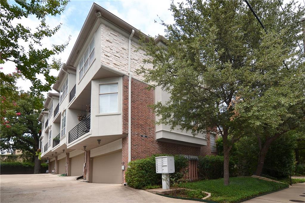 Fabulous 3 story townhome just steps from the Katy Trail and offers downtown views. Easy to entertain with the open floor plan that features wood floors throughout the 2nd floor.Kitchen has gorgeous cherry wood cabinets in a contemporary fashion and granite counter tops. Cast stone fireplace makes the living area cozy. Two dreamy balconies, one off the living area and another off of the master bedroom with views of the Dallas skyline. Baths have marble flooring.