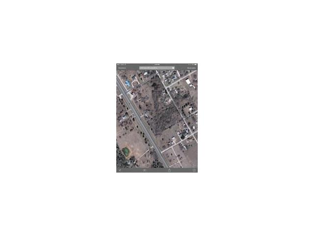 Corner lot in McDade, TX!  Possible site for convenient store, retail shopping, many more possibilities.
